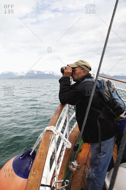 July 12, 2010: USA, Alaska, Homer, a man takes a ride on the Danny J boat from the Homer Spit to Halibut Cove