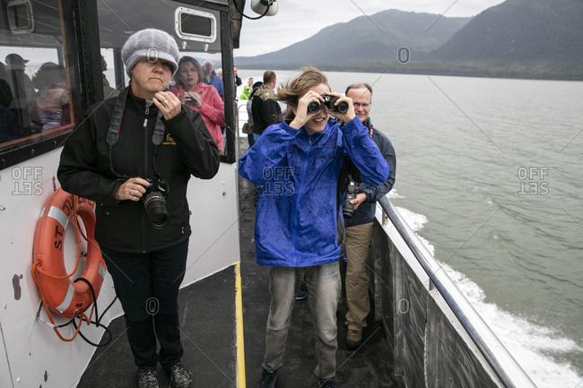 January 1, 2000: USA, Alaska, Juneau, passangers keep their eyes peeled for Humpback Whales while whale watching and exploring in Stephens Passage
