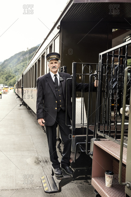 January 1, 2000: USA, Alaska, Sitka, one of the train conductors aboard the White Pass & Yukon Route Railroad from the town of Sitka up and into Canada