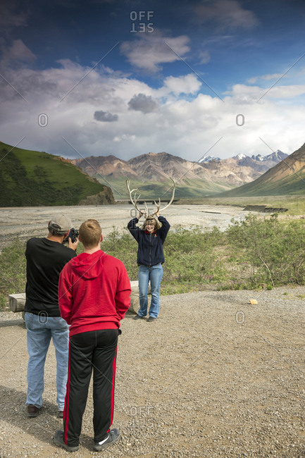 June 29, 2015: USA, Alaska, Denali, Denali National Park, guests pose for photographs during a break on the wildlife viewing drive tour through the park