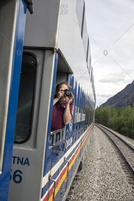 June 30, 2015: USA, Alaska, Denali National Park, passengers step outside the McKinley Explorer to take pictures of the picturesque scenery along the Alaska Railway from Denali to Anchorage