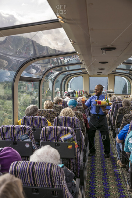 June 30, 2015: USA, Alaska, Denali National Park, the McKinley Explorer can seat 86 to 88 passengers in the upper level dome which offers a 360 degree view, these passengers are traveling the Alaska Railway from Denali to Anchorage