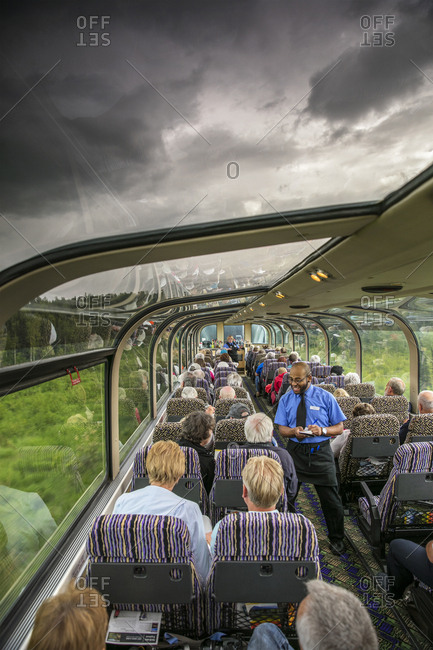 July 1, 2015: USA, Alaska, Denali National Park, the McKinley Explorer can seat 86 to 88 passengers in the upper level dome which offers a 360 degree view, these passengers are traveling the Alaska Railway from Denali to Anchorage