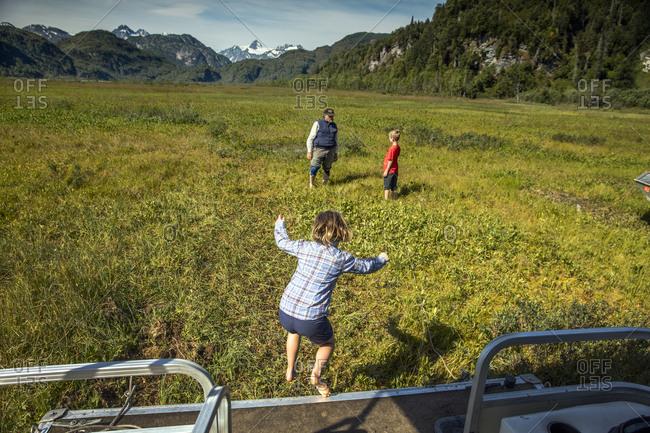 July 23, 2016: USA, Alaska, Redoubt Bay, Big River Lake, playing on the floating marsh near Redoubt Bay