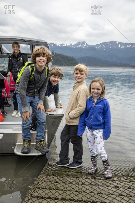 July 30, 2016: USA, Alaska, Homer, China Poot Bay, Kachemak Bay, children loading onto a boat at Kachemak Bay Wilderness Lodge