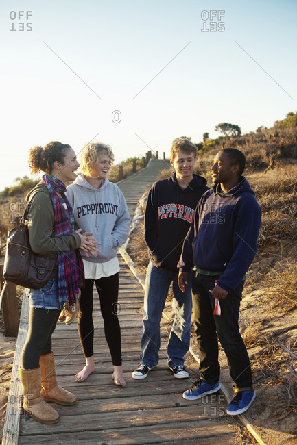October 8, 2010: USA, California, Malibu, students from Pepperdine University stand and talk on the Big Dume boardwalk