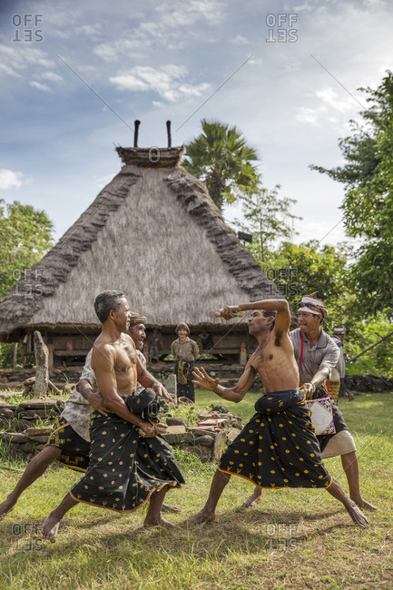 July 16, 2013: INDONESIA, Flores, men demonstrates traditional boxing in Kampung Tutubhada village in Rendu