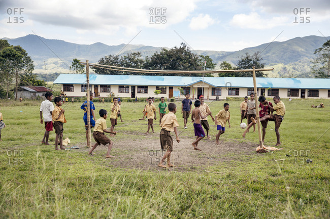 July 17, 2013: INDONESIA, Flores, Poma School kids play soccer in Denatana Timur village