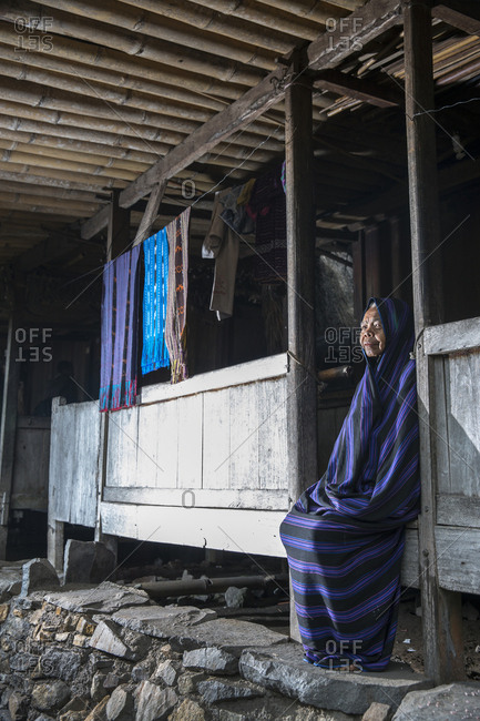 July 17, 2013: INDONESIA, Flores, portrait of an elder weaver in front of her home at Bena village