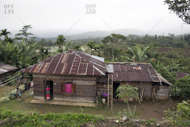 July 19, 2013: INDONESIA, Flores, a woman washes her feet outside of her home in Gololowi which is a small subdistrict of Borong