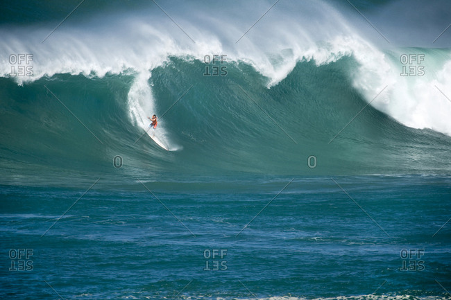December 8, 2009: USA, Hawaii, surfer before wipeout on a wave at Waimea bay, the North Shore Oahu