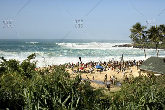 December 8, 2009: USA, Hawaii, Oahu, elevated view of people watching the Eddie Aikau surfing competition, Waimea Bay