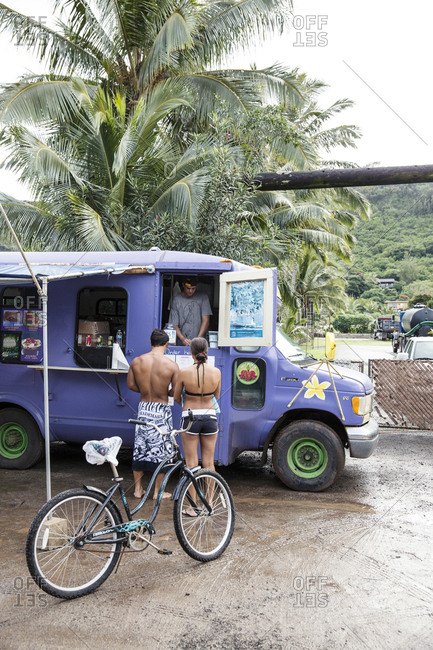 February 9, 2014: USA, Oahu, Hawaii, portrait of MMA Mixed Martial Arts Ultimate fighter Lowen Tynanes and Logan Garcia buy Acai Bowls at a food truck on the North Shore of Oahu