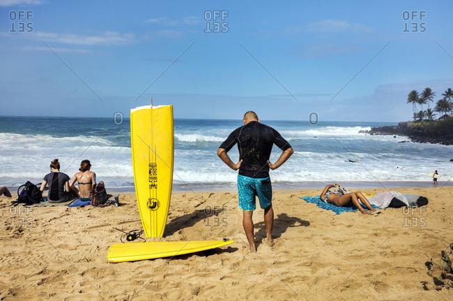February 24, 2016: HAWAII, Oahu, North Shore, surfers at Waimea Bay