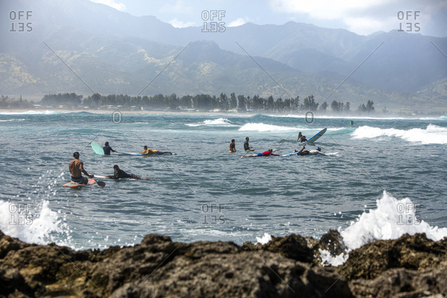 February 29, 2016: HAWAII, Oahu, North Shore, individuals surfing at Puaena Point Beach Park
