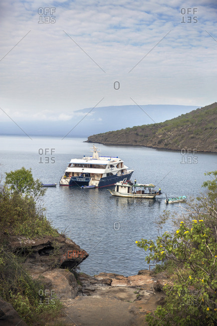 March 24, 2014: GALAPAGOS ISLANDS, ECUADOR, Tangus Cove, the M/C Ocean Spray moored in the bay off Tangus Cov