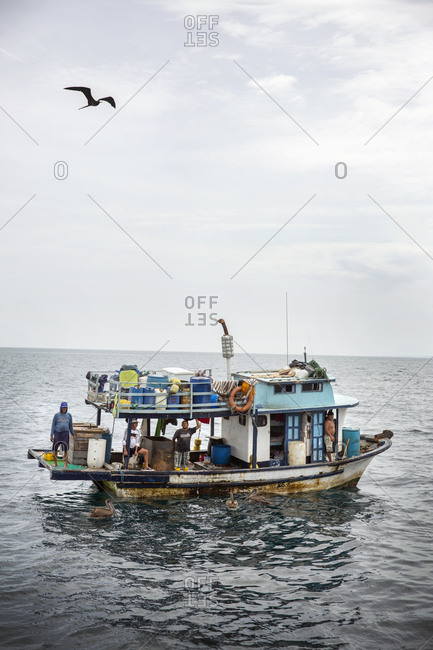 March 24, 2014: GALAPAGOS ISLANDS, ECUADOR, a fishing boat seen from aboard the M/C Ocean Spray near Tangus Cove