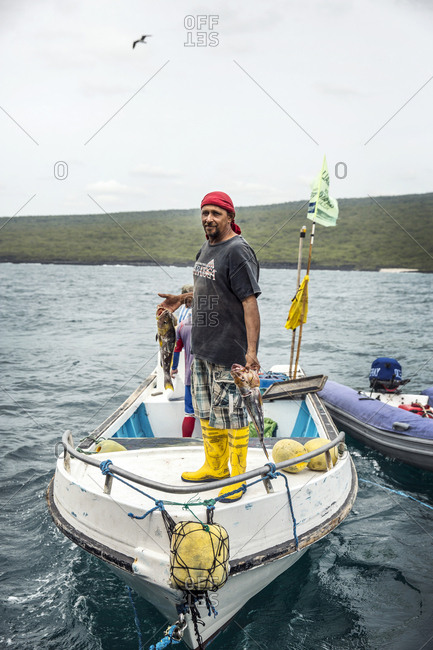March 24, 2014: GALAPAGOS ISLANDS, ECUADOR, local fishermen sell fish to the M/C Ocean Spray
