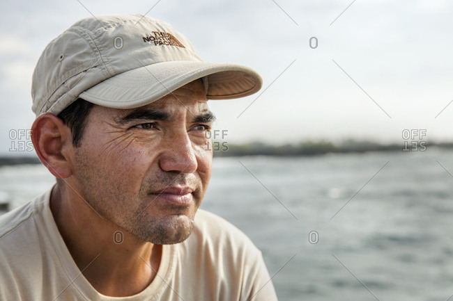 March 25, 2014: GALAPAGOS ISLANDS, ECUADOR, one the guides driving the boat into Punta Moreno from  M/C Ocean Spray