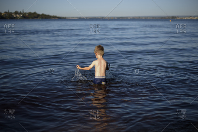 Boy splashing in the river