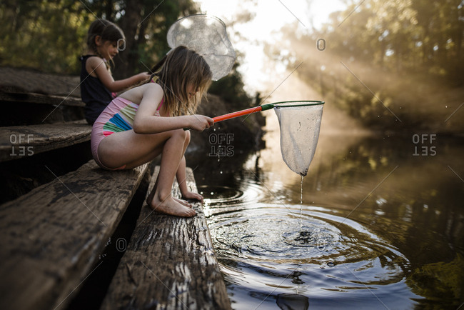 Girls fishing with nets