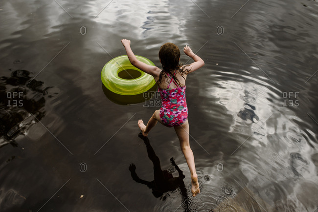Girl jumping into the river
