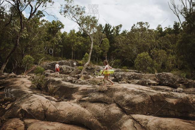 Children playing on rocks