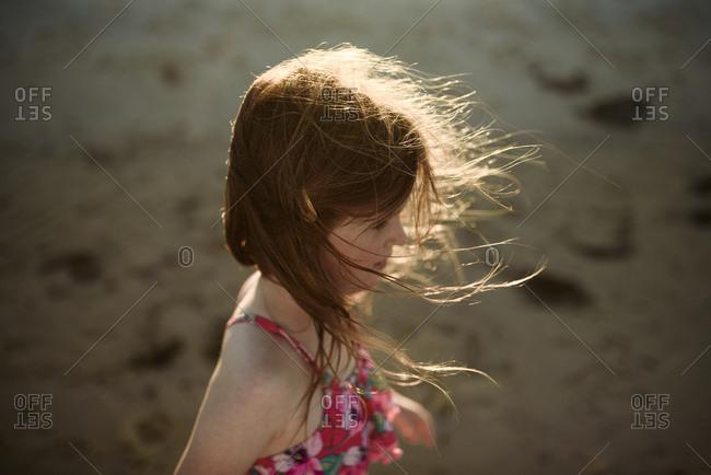 Girl walking on foreshore