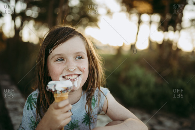 Happy girl eating ice cream