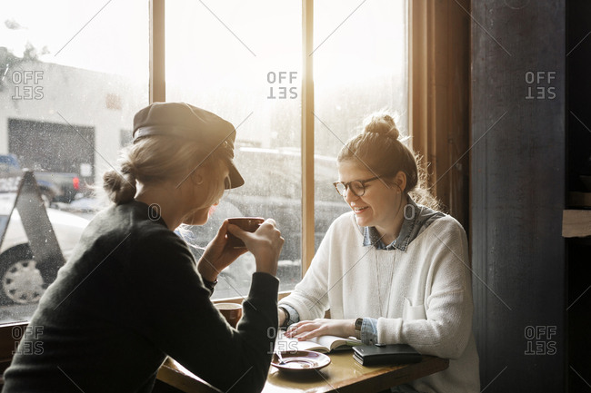 Two young women hanging out at cafe