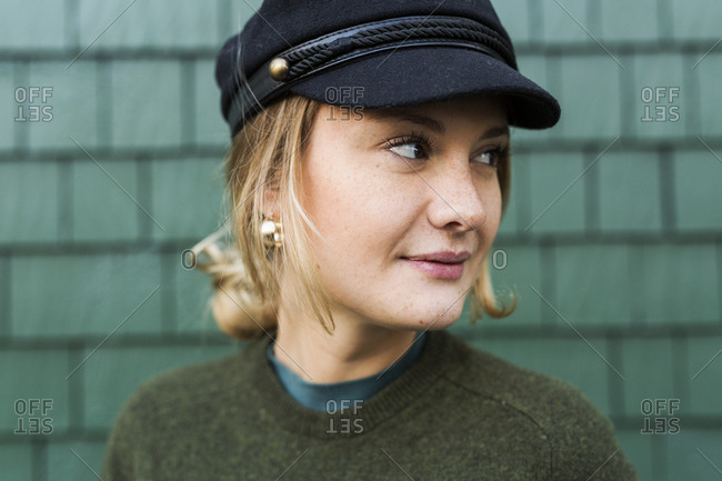 Portrait of young woman wearing cap