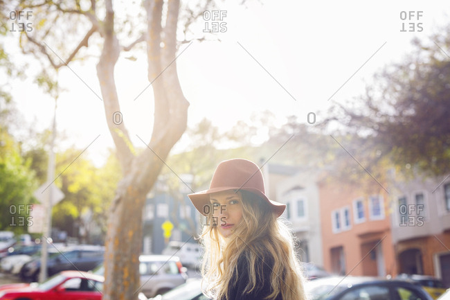 Portrait of young blonde woman in sunlight
