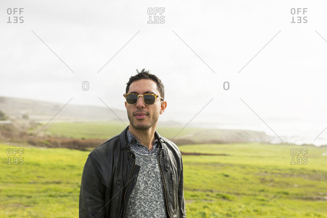 Portrait of man wearing black leather jacket and sunglasses