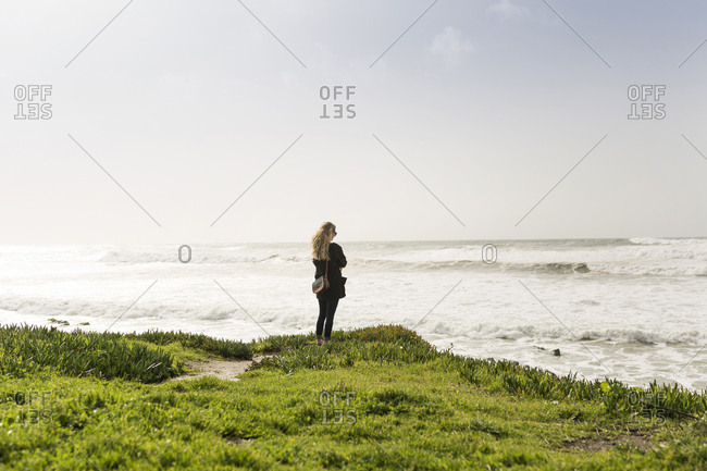 Young woman looking at seascape
