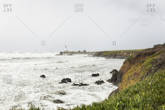 Scenic view of coastline with overcast sky