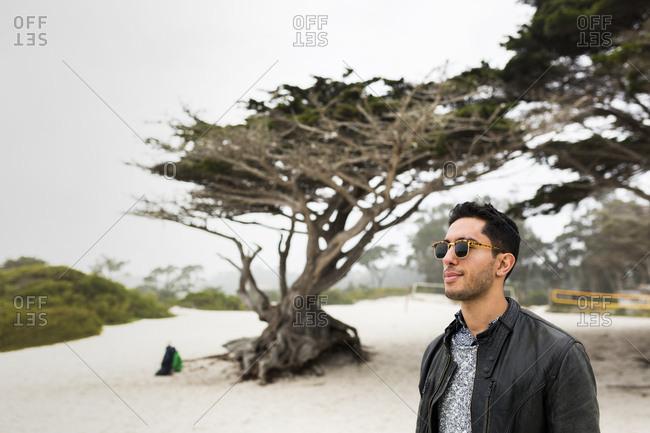 Man wearing sunglasses at beach