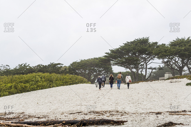 Group of friends hanging out at beach