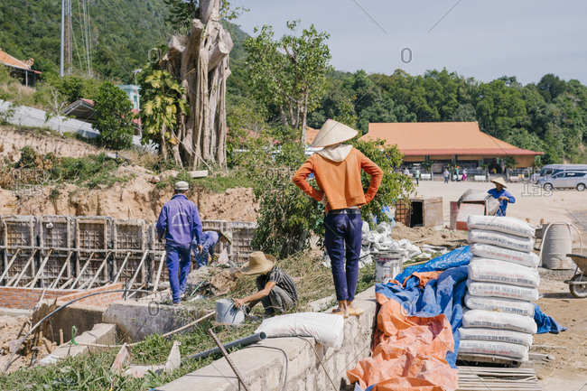 Phu Quoc, Vietnam - January 19, 2019: Vietnamese builders working at the construction site of a villa.
