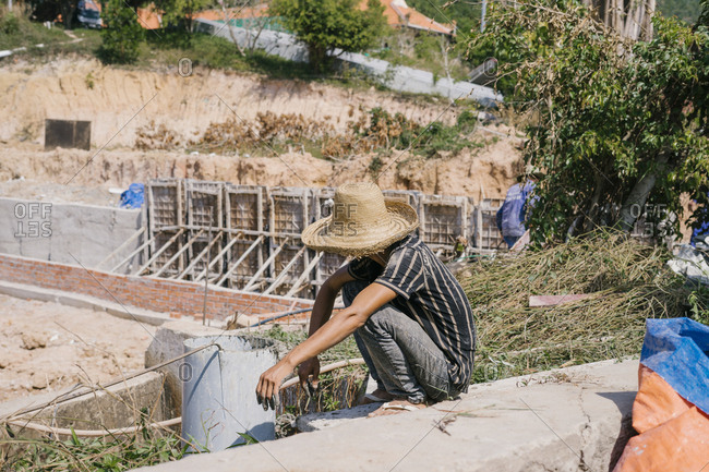 Vietnamese builders working at the construction site. construction of a villa.