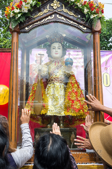 January 26, 2019: People worshiping the sacred image of The Santo Nino. Panglao Island, Bohol, Philippines