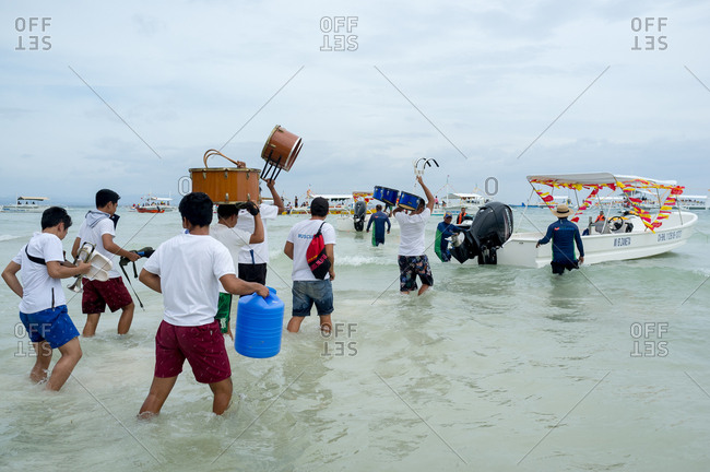 January 26, 2019: People boarding a boat in the celebrations of The Santo Nino. Panglao Island, Bohol, Philippines