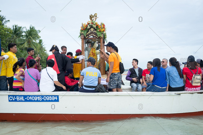 January 26, 2019: People placing the image of The Santo Nino on a boat. Panglao Island, Bohol, Philippines