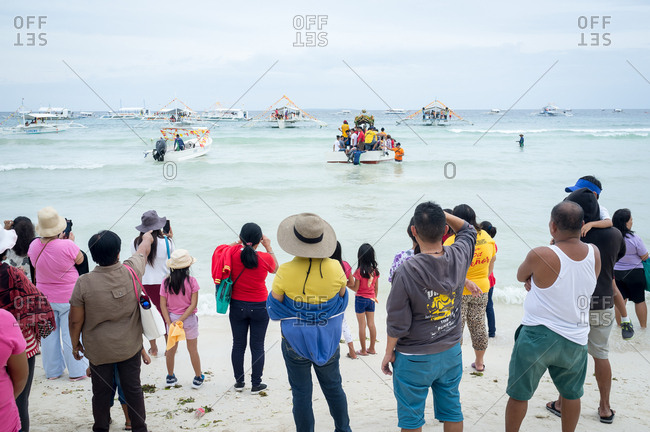January 26, 2019: People looking the marine parade of The Santo Nino. Panglao Island, Bohol, Philippines