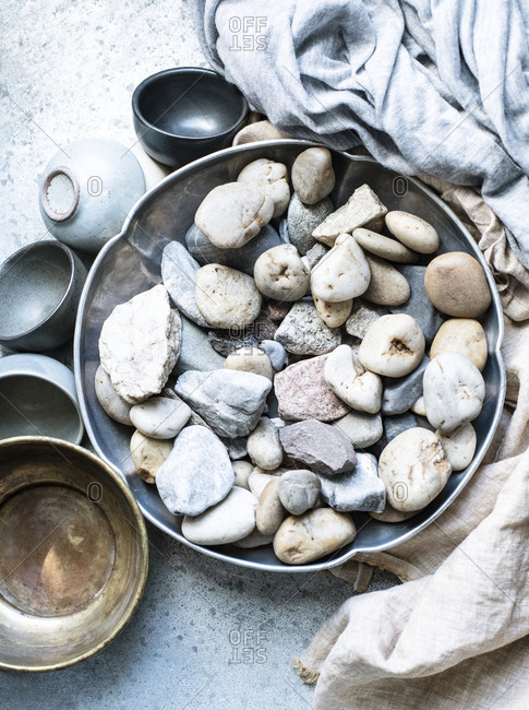 A collection of stones in a silver bowl