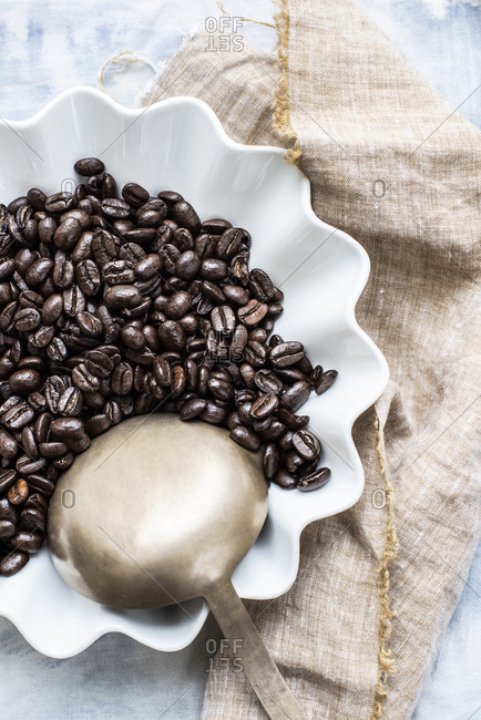 Coffee beans in white ceramic bowl