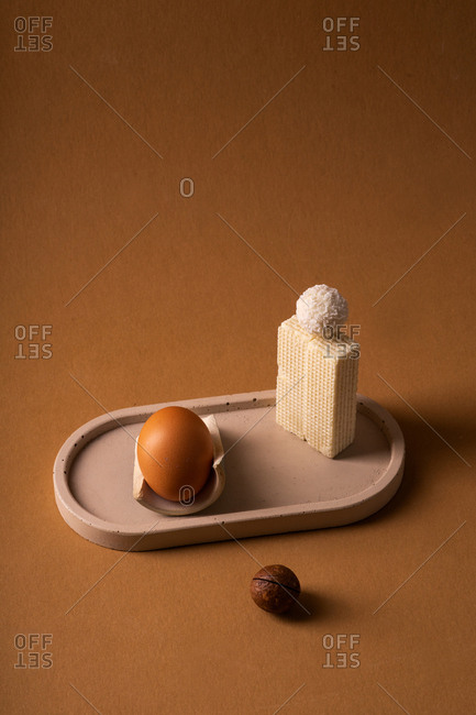 Abstract still life with egg in beige palette