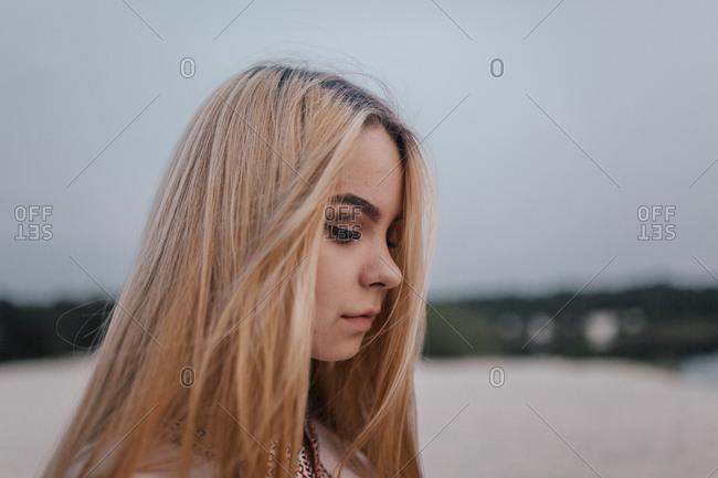 Dreamy girl in profile close-up