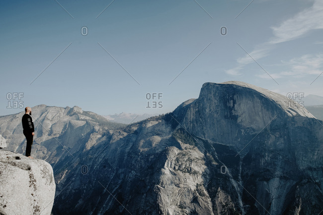 Man Standing at end of Half Dome hike in Yosemite National Park
