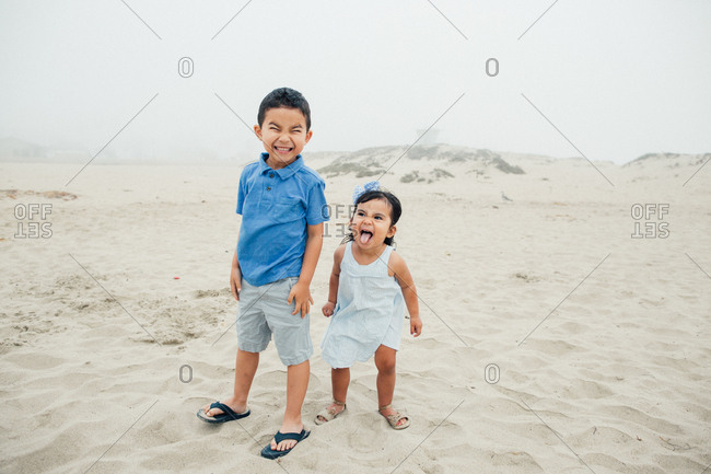Silly Faces From Siblings At The Foggy Beach
