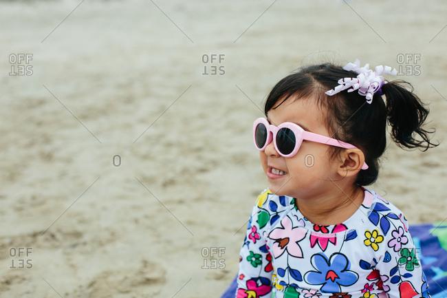 Toddler Girl Profile Wearing Pink Sunglasses
